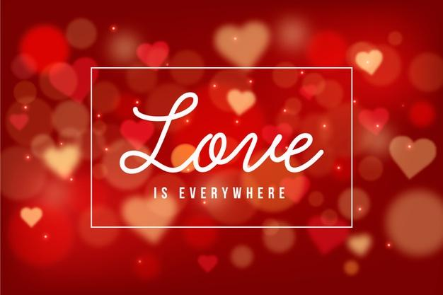 Valentine's day background with blurred hearts Free Vector